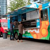 "Atlanta, GA, USA - October 16, 2014:  Customers order meals from a popular food truck during their lunch hour, at ""Food Truck Thursday"" in Atlanta."