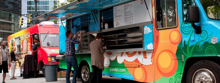 """Atlanta, GA, USA - October 16, 2014:  Customers order meals from a popular food truck during their lunch hour, at """"Food Truck Thursday"""" in Atlanta."""