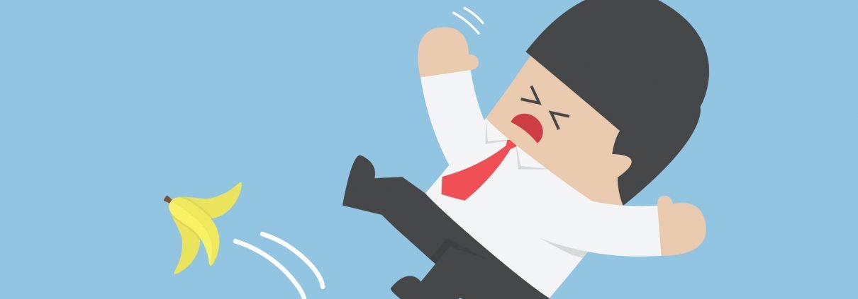 Businessman slipping on a banana peel, VECTOR, EPS10