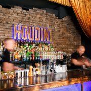GRODNO, BELARUS - NOV 7, 2015: Two bartenders quickly working at a gastrobar HOUDINI in Grodno, Belarus, November 7, 2015